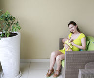 Young beautiful mother is breast feeding baby. Royalty Free Stock Images