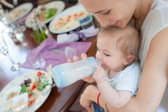 Beautiful Baby Mother Feeding Restaurant Royalty Free Stock Photos