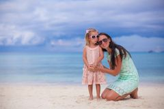 Young beautiful mother and her adorable little Stock Images