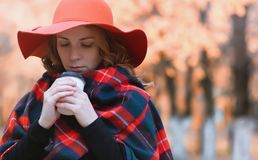 Girl in autumn city park in leaf fall. Young beautiful mother wi Royalty Free Stock Photos