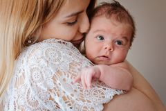 Young beautiful mother with her newborn baby girl royalty free stock photography