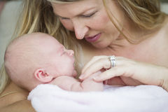 Young Beautiful Mother Holding Her Precious Newborn Baby Girl Royalty Free Stock Photo