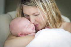 Young Beautiful Mother Holding Her Precious Newborn Baby Girl Stock Photography