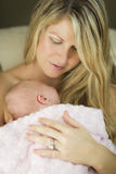 Young Beautiful Mother Holding Her Precious Newborn Baby Girl Stock Photo