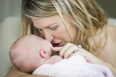 Young Beautiful Mother Holding Her Precious Newborn Baby Girl Royalty Free Stock Image