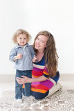 Young beautiful mother hugging her child Stock Photo