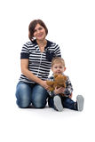 Young beautiful mother in jeans sitting with her son three years Royalty Free Stock Photos