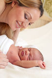 Young beautiful mother and newborn baby boy Stock Photo