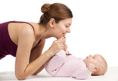 Young beautiful mother and newborn baby boy Stock Photos