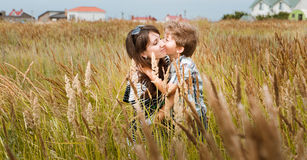 Young beautiful mother with son having fun on the lawn with gree Stock Photo