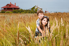 Young beautiful mother with son having fun on the lawn with gree Royalty Free Stock Photos