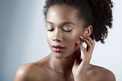 Young beautiful mulatto girl with clean perfect skin close-up. Beauty portrait Stock Photos