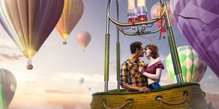 Young beautiful multiethnic couple kissing in the hot air balloon. stock images