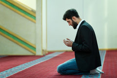 Young beautiful Muslim Man Praying In Mosque Stock Image