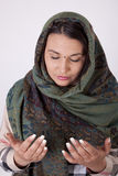 Young beautiful muslim woman. With a scarf on her head praying Royalty Free Stock Images