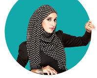 Young beautiful muslim woman with black scarf. Fashion portrait of young beautiful muslim woman with black scarf Royalty Free Stock Images