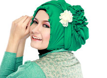Young beautiful muslim woman with green costume wearing hijab Royalty Free Stock Photo