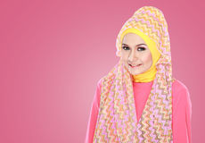 Young beautiful muslim woman with pink costume wearing hijab Royalty Free Stock Images