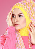 Young beautiful muslim woman with pink costume wearing hijab Stock Images