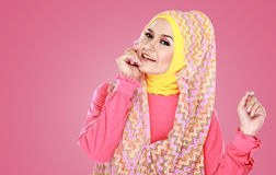 Young beautiful muslim woman with pink costume wearing hijab Stock Photo