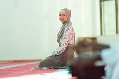 Young beautiful Muslim Woman Praying In Mosque Stock Photo