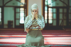 Young beautiful Muslim Woman Praying In Mosque Royalty Free Stock Photo