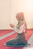 Young beautiful Muslim Woman Praying In Mosque Royalty Free Stock Image