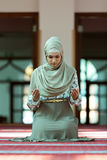 Young beautiful Muslim Woman Praying In Mosque Stock Image