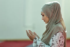 Young beautiful Muslim Woman Praying In Mosque.  Royalty Free Stock Photo