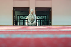 Young beautiful Muslim Woman Praying In Mosque.  Stock Image