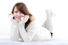 The young beautiful naked girl on. A white background in a white sweater Stock Photo