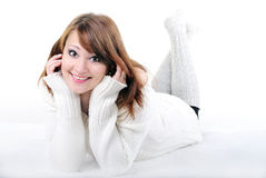 The young beautiful naked girl on. A white background in a white sweater Royalty Free Stock Photography