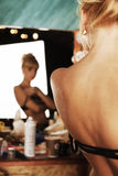Young beautiful naked woman model. In the mirror Royalty Free Stock Photo