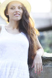Young beautiful natural brunette woman in the hat at summer suns Royalty Free Stock Photo