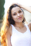 Young beautiful natural brunette woman at summer sunset portrait Royalty Free Stock Photos