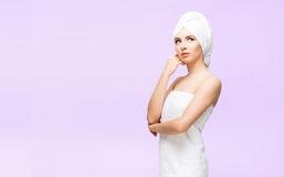 Young, beautiful and natural woman in towel. Spa concept with copyspace. stock photo