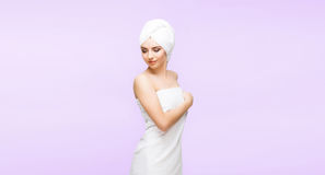 Young, beautiful and natural woman in towel. Spa concept with copyspace. royalty free stock photo