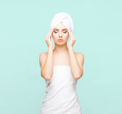 Young, beautiful and natural woman wrapped in towel isolated on. Young, beautiful and natural woman wrapped in towel over cyan background stock photo