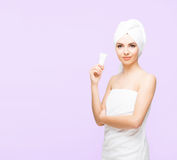 Young, beautiful and natural woman wrapped in towel isolated on. Young, beautiful and natural woman wrapped in over magenta background stock image