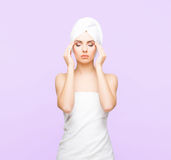 Young, beautiful and natural woman wrapped in towel isolated on. Young, beautiful and natural woman wrapped in over magenta background stock photo