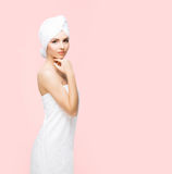 Young, beautiful and natural woman wrapped in towel isolated on. Young, beautiful and natural woman wrapped in towel over orange background stock photos