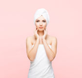Young, beautiful and natural woman wrapped in towel isolated on. Young, beautiful and natural woman wrapped in towel over orange background stock images