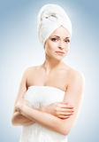Young, beautiful and natural woman wrapped in towel Stock Photography