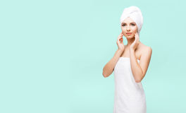 Young, beautiful and natural woman wrapped in towel over cyan ba. Young, beautiful and natural woman in towel. Spa concept with copyspace stock photos
