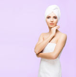 Young, beautiful and natural woman wrapped in towel on. Young, beautiful and natural woman wrapped in over magenta background stock image
