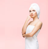 Young, beautiful and natural woman wrapped in towel isolated on Royalty Free Stock Photo