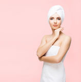Young, beautiful and natural woman wrapped in towel isolated on Stock Images