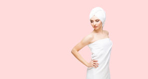 Young, beautiful and natural woman wrapped in towel over orange. Young, beautiful and natural woman in towel. Spa concept with copyspace royalty free stock photos