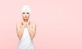 Young, beautiful and natural woman wrapped in towel over orange. Young, beautiful and natural woman in towel. Spa concept with copyspace stock images