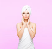 Young, beautiful and natural woman wrapped in towel  on Royalty Free Stock Photos
